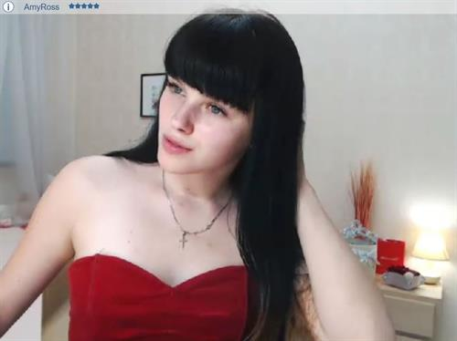 Russian webcam model in red, found on ImLive.com